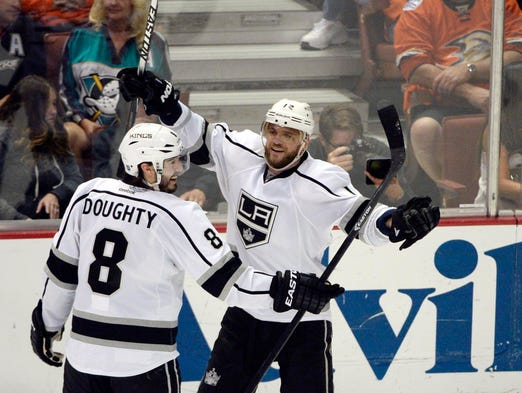 Los Angeles Kings right wing Marian Gaborik (12) celebrates with defenseman Drew Doughty (8) after scoring a goal against the Anaheim Ducks during the second period in game seven.