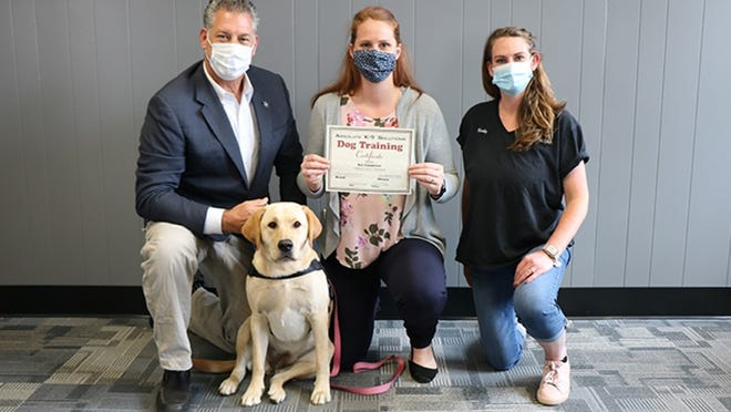 Middlesex Sheriff Peter J. Koutoujian (from left), K-9 therapy dog Millie, Lowell Community Counseling Director Jillian Ketchen and Vicky Nee of Absolute K-9 Solutions.