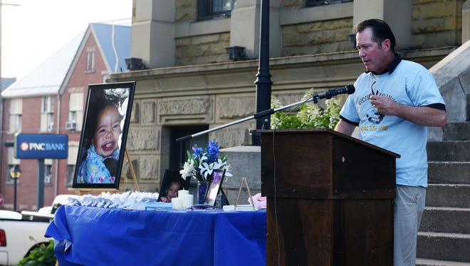 Guest speaker John Burris pauses for a moment while addressing the crowd at a vigil held for Lillion Rose Hamilton on Saturday in front of the Guernsey County Court House in Cambridge. Hamilton died on June 29 at Children's Hospital after being found unresponsive in her home in Cambridge.