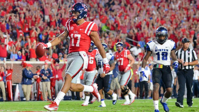 Ole Miss tight end Evan Engram posted four catches for 82 yards and a touchdown against Memphis.
