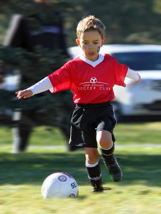 Carter Smailes kicking a soccer ball.jpg