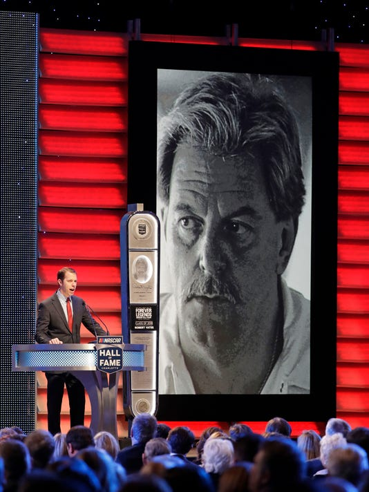 Brad Keselowski, left, speaks as Robert Yates is inducted into the NASCAR Hall of Fame in Charlotte, N.C., Friday, Jan. 19, 2018. (AP Photo/Chuck Burton)