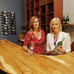 Sisters Marla Milner, left, and Michelle Wise of Cellar 422 Friday, August 28, 2015, at 422 Main Street in downtown Lafayette. Wise worked for several years in the wine industry while living in California. She and her sister decided to open the wine shop/bistro to fill a niche demand in Lafayette.