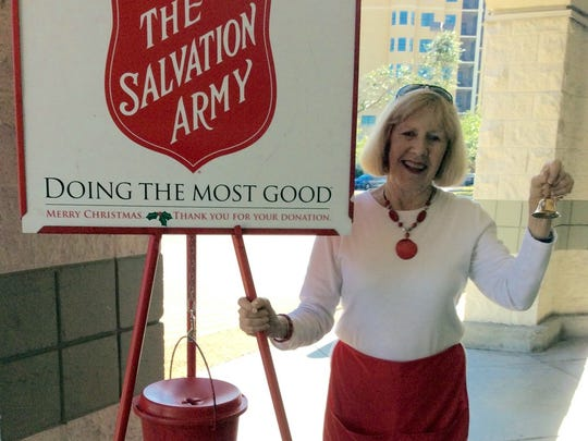 Celebrating her 10th year of bell ringing on Marco Island is Virginia Bingle.