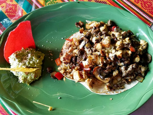 Guatemex's  chicken and steak gringas are sort of a combination taco/ quesadilla. The flour tortillas are loaded with chipped steak and chicken along with grilled mushrooms, onions, and peppers layered with gooey Chihuahua cheese.