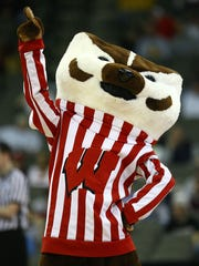 The Wisconsin Badgers take on the Kentucky Wildcats on Saturday night in Indianapolis. And, yes, Bucky wins the mascot battle.
