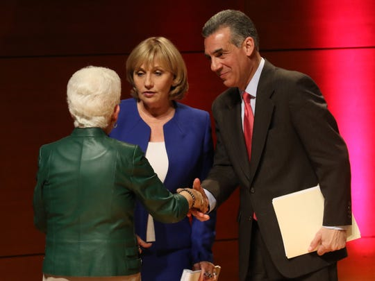 Debate moderator Sharon Schulman, executive director of the William J. Hughes Center for public policy at Stockton University with Republican gubernatorial candidates Kim Guadagno  and Jack Ciattarelli at the conclusion of their debate.