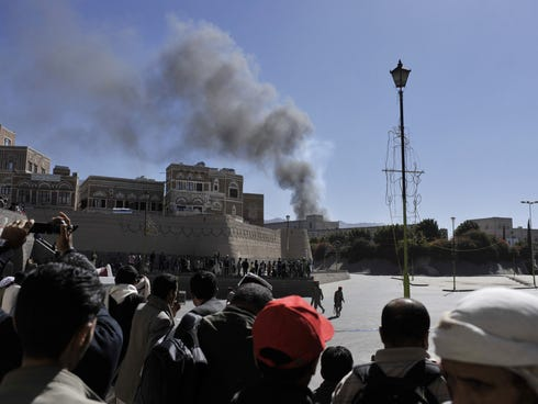Smoke raises after an explosion at the Defense Ministry complex in Sanaa, Yemen, on Dec. 5, 2013.