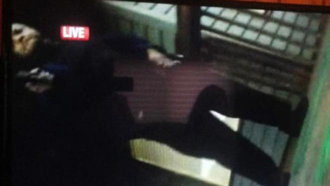 In this framegrab from video made by the camera of WDBJ-TV cameraman Adam Ward, Vester Lee Flanagan II stands over Ward with a gun after fatally shooting him and reporter Alison Parker during a live on-air interview in Moneta, Va., Aug. 26, 2015.