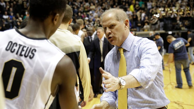 Michigan basketball coach John Beilein shakes hands with Purdue guard Jon Octeus following a game in West Lafayette, Ind., on Jan. 3, 2015.
