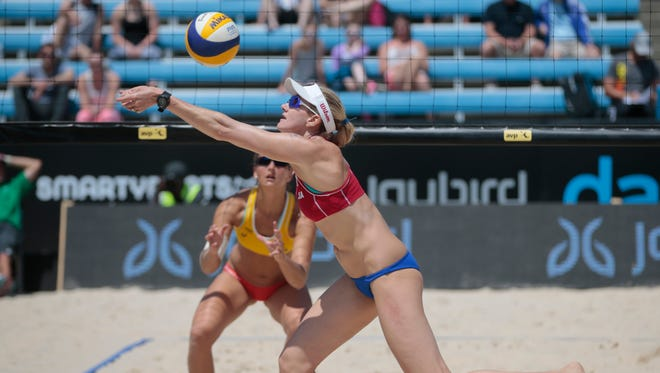 Kerri Walsh, of the United States, bumps the ball during the match against Teresa Merman and Isabel Schneider, of Germany, Thursday, May 19, 2016, at the AVP/FIVB Cincinnati Open in Mason, Ohio.