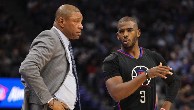 LA Clippers guard Chris Paul (3) talks with Clippers head coach Doc Rivers during the second quarter at Golden 1 Center.
