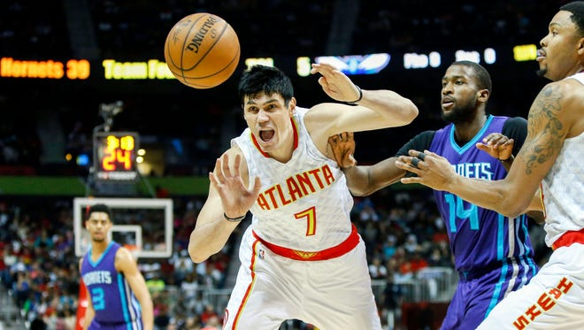 Apr 11, 2017; Atlanta, GA, USA; Atlanta Hawks forward Ersan Ilyasova (7) reaches for a loose ball past Charlotte Hornets forward Michael Kidd-Gilchrist (14) in the second quarter at Philips Arena. Mandatory Credit: Brett Davis-USA TODAY Sports