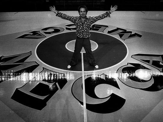 Artist Robert Indiana with MECCA floor he designed.