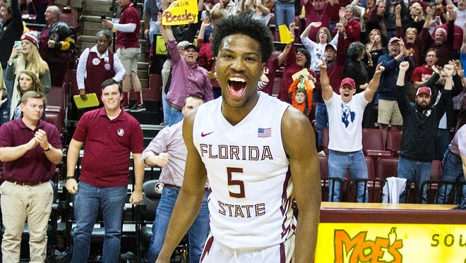 Florida State guard Malik Beasley (5) reacts at the buzzer after defeating Virginia 69-62 in an NCAA college basketball game in Tallahassee, Fla., Sunday, Jan. 17, 2016.