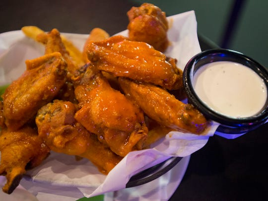 A basket of hot wings is served at Ryan's Sports Grill on Harmony Road Thursday, January 26, 2017.