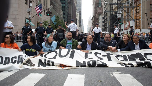 Activists sit on Fifth Avenue in an action of civil