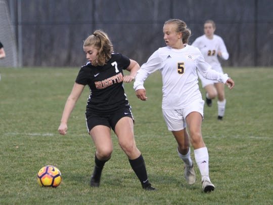 Brighton's Isabel Stropich (7) and Hartland's Maria
