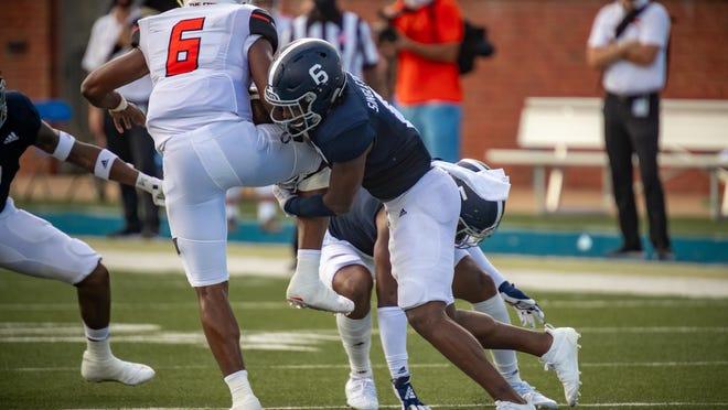 Georgia Southern safety Java'n Singletary (6 in blue) tackles Campbell quarterback Hajj-Malik Williams (6 in white) on Sept. 12 at Paulson Stadium in Statesboro.