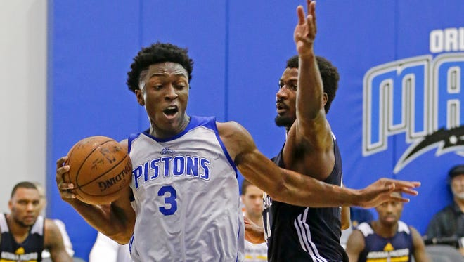 Detroit Pistons' Stanley Johnson (3) gets around Indiana Pacers' Solomon Hill (44) on his way to the basket during the second half of an NBA summer league basketball game, Wednesday, July 8, 2015, in Orlando, Fla.
