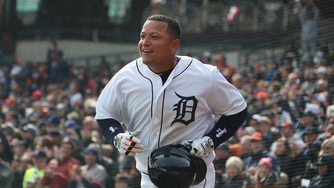 Miguel Cabrera smiles after crossing home plate in the 7th inning, giving the Tigers a 5-4 lead over the Pirates at Comerica Park on Friday.