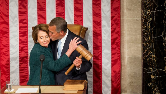 House Speaker John Boehner of Ohio kisses House Minority Leader Rep. Nancy Pelosi of Calif. after being re-elected to a third term during the opening session of the 114th Congress, as Republicans assume full control for the first time in eight years, Tuesday, Jan. 6, 2015, on Capitol Hill in Washington. AP Photo/Pablo Martinez Monsivais )