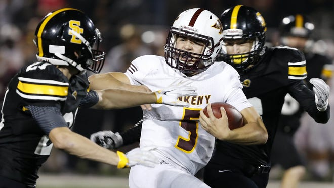Ankeny quarterback Blaine Hawkins (5) tries to break away from Southeast Polk defenders on Friday.