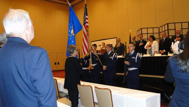 The Vineland High School Air Force JROTC Color Guard presents the colors during the New Jersey Credit Union League's annual convention.