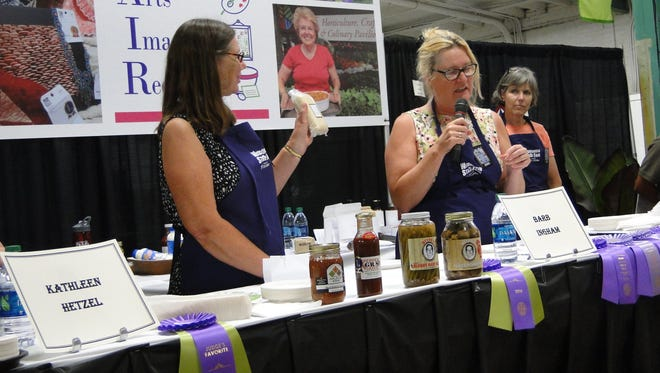 Culinary judges Kathy Hetzel, Barb Ingrahm and Tera Johnson evaluate the packaging of the entries from 22 entrepreneurs who make food products to market.