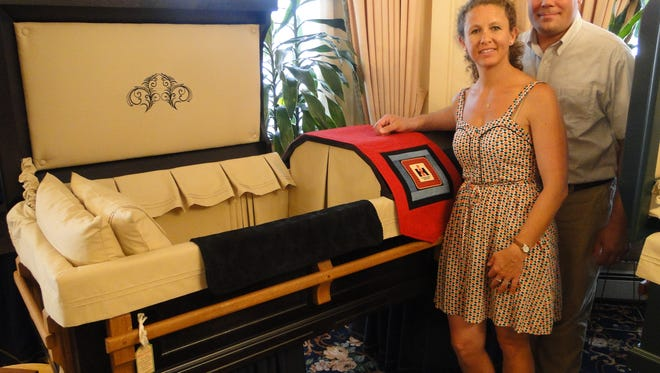 Jonas and Julie Zahn are in the tree planting business and they finance it by making wood caskets and utilizing all natural, nontoxic finishes and furnishings. Pictured is a casket with the IH implement design featured.