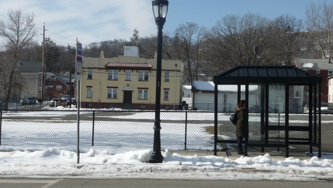 Haledon officials are tweaking plans to revive the site of the former municipal building as a village square.