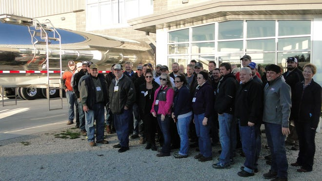 PDPW members learn from one another.  One way is by networking at conferences.  Another is by taking part in technology tours offered by the organization.  Here members are gathered at the Kinnard farm in Kewaunee County to see that farm's latest technologies.