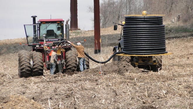 More and more farmers are recognizing the benefits of tiling land to improve drainage and over-all soil health.  UW-Discovery Farms has found that corrugated plastic tile is better than the older concrete tile systems.
