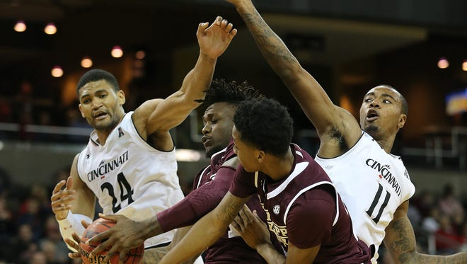 Cincinnati Bearcats forwards Kyle Washington (24) and Gary Clark (11) will try to help UC extend its home-court winning streak to 36 on Saturday, when East Carolina visits.