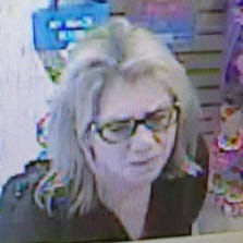 Police say this woman is a suspect in the July 15 theft of a stuffed animal puppet from the Genuine Toy Company in downtown Plymouth.