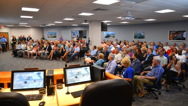 Luis Ajamil of Bermello Ajamil & Partners presented Port Canaveral's strategic master plan to a capacity crowd at Port Canaveral Monday morning. After the meeting, the crowd looked at displays of the different components of the presentation.