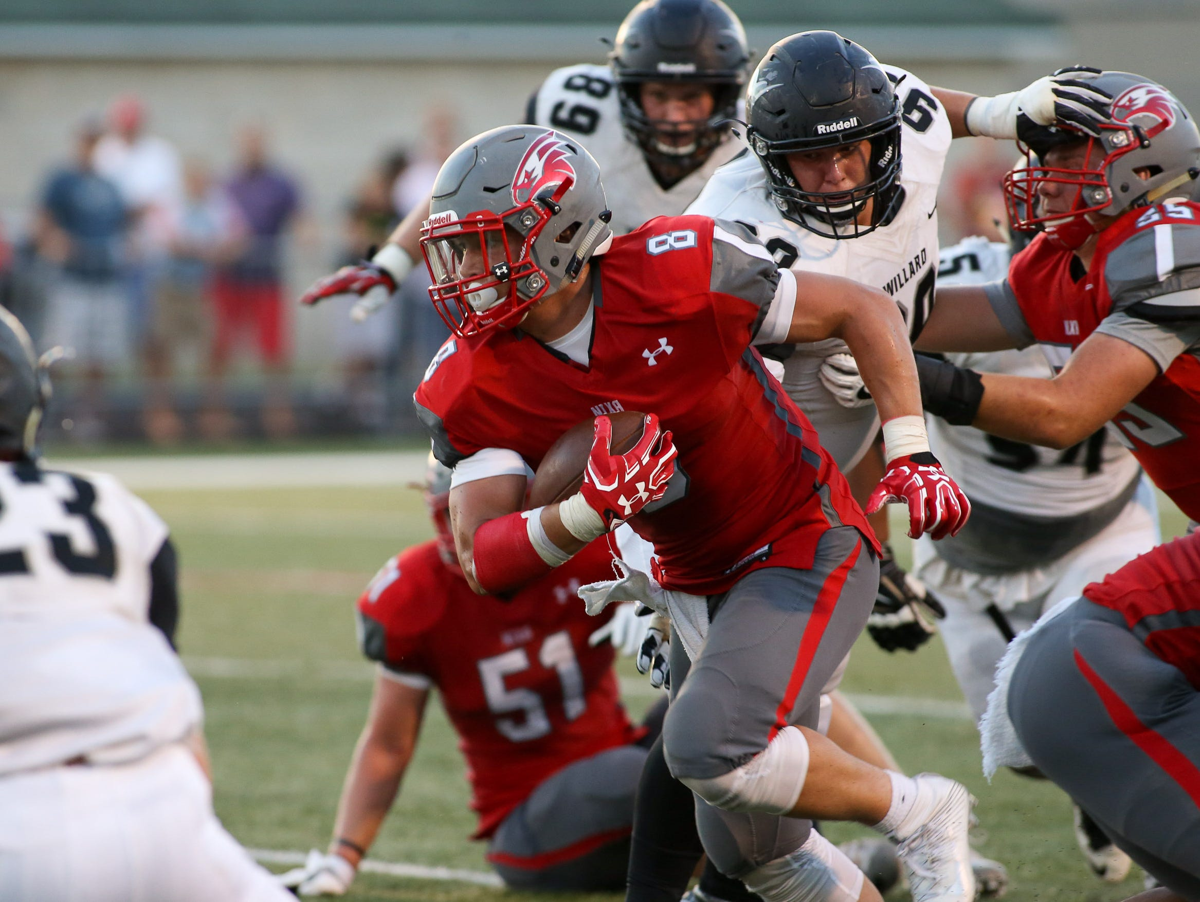 Nixa High School's Hayden Young tries to get away from Willard High School's defense Friday, August 19, 2016. Jason Connel / For the News-Leader