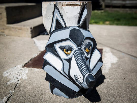David Mitchell has spent the last several months working on a more than twenty foot tall sculpture outside of a home on Main Street in Muncie.