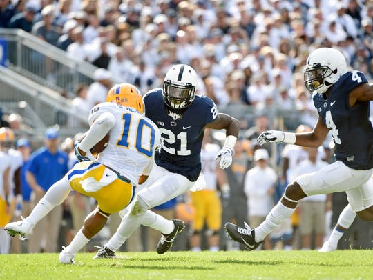 Penn State's Amani Oruwariye (21) and Nick Scott (4)