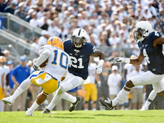Penn State's Amani Oruwariye (21) and Nick Scott (4) prepare to stop Pittsburgh's Quadree Henderson in the first half of an NCAA Division I college football game Saturday, Sept. 9, 2017, at Beaver Stadium. Penn State defeated Pitt 33-14.