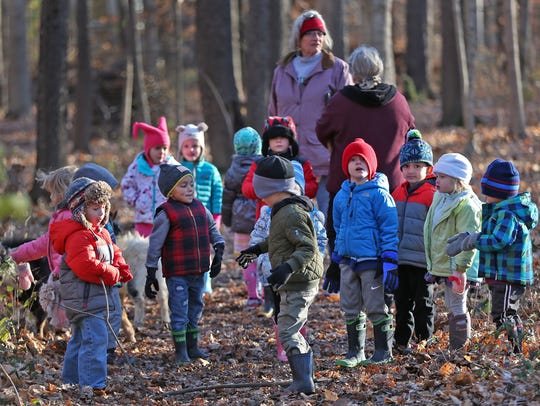 Kids go on a walk in the woods during an outdoor learning time at The Orchard School, Wednesday, Dec. 6, 2017. The northern-Indianapolis private school commits to learning outside for at least two hours every day.