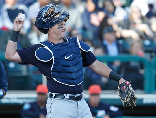 Tiers catcher James McCann throws the ball during the