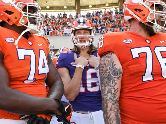 Clemson quarterback Trevor Lawrence (16) waits to get