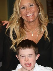 James Rink, 9, with his mom, LynnMarie Rink