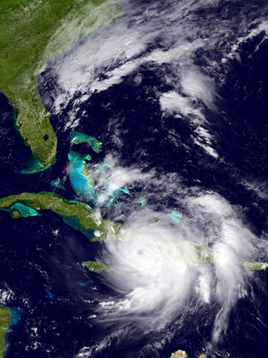 The GOES East satellite image provided by the National Oceanic and Atmospheric Administration (NOAA) and taken Tuesday, Oct. 4, 2016 at 1:12 p.m. EDT, shows Hurricane Matthew over the Caribbean region.  Hurricane Matthew roared across the southwestern tip of Haiti with 145 mph winds Tuesday, Oct. 4, 2016, uprooting trees and tearing roofs from homes in a largely rural corner of the impoverished country as the storm headed north toward Cuba and the east coast of Florida.