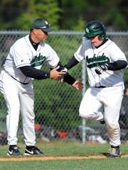 Parkside Coach Brian Hollamon congratulates Zach Townsend as he rounds third after hitting a 3-run homer in the bottom of the sixth Wednesday to give his team a 6 to 1 lead over James M. Bennett.