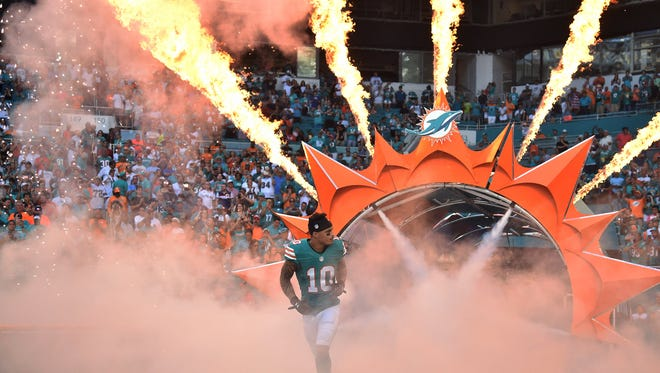 Nov 27, 2016; Miami Gardens, FL, USA; Miami Dolphins wide receiver Kenny Stills (10) is being introduced before a game against San Francisco 49ers at Hard Rock Stadium.