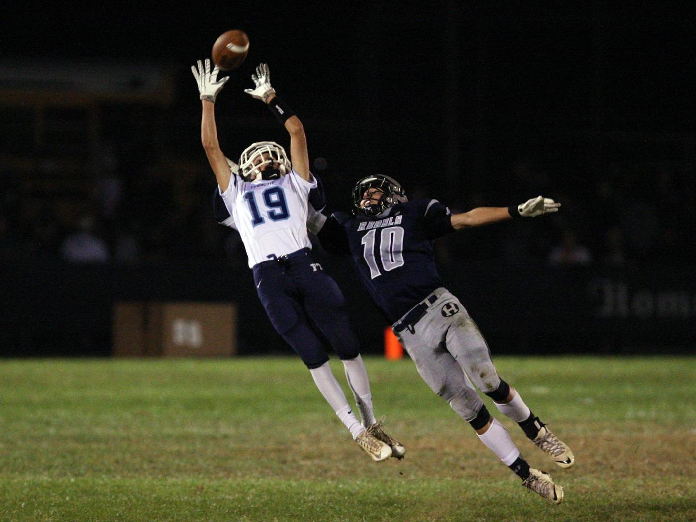Pat Laricy, #15 Freehold Township, almost makes the interception as intended receiver Nic Rossi, #10 Howell, tries to defend against him in a football game Friday, September 25, 2015, at Howell High School.