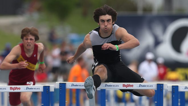 Solon junior Connor Ham clears the last hurdle to win the 110-meter hurdles in Iowa Class 3-A on Saturday, May 24, 2014, during the Iowa state high school track and field meet at Drake Stadium in Des Moines.