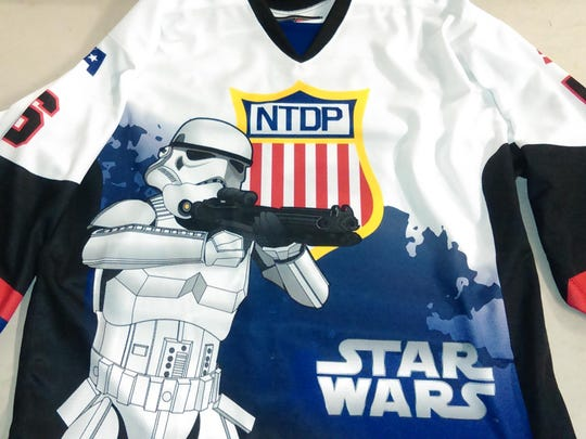 USA Hockey NTDP players will wear this Star Wars theme jersey Saturday night. Jerseys will be auctioned online following the game.